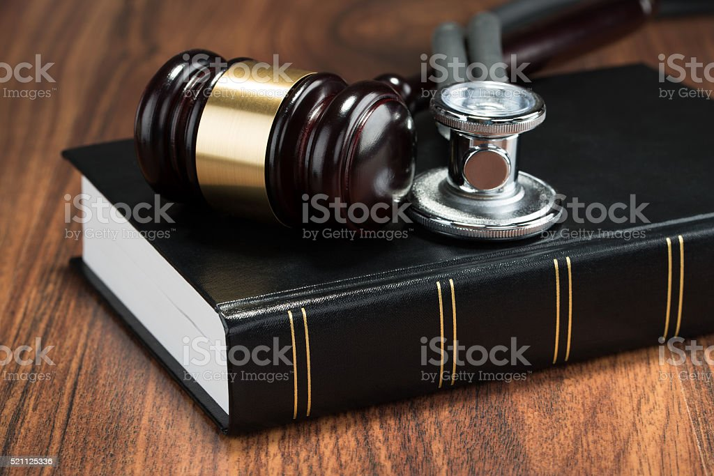 Gavel And Stethoscope On Book stock photo