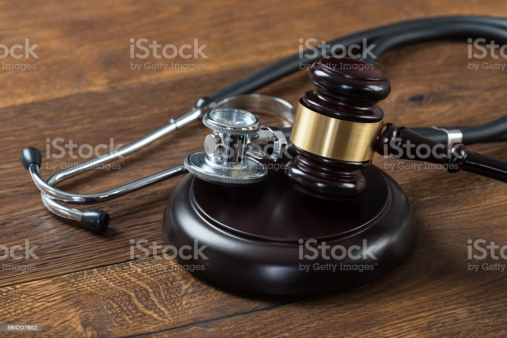 Gavel And Stethoscope On Table stock photo