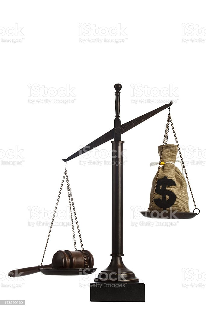 Gavel and US currency on scale royalty-free stock photo
