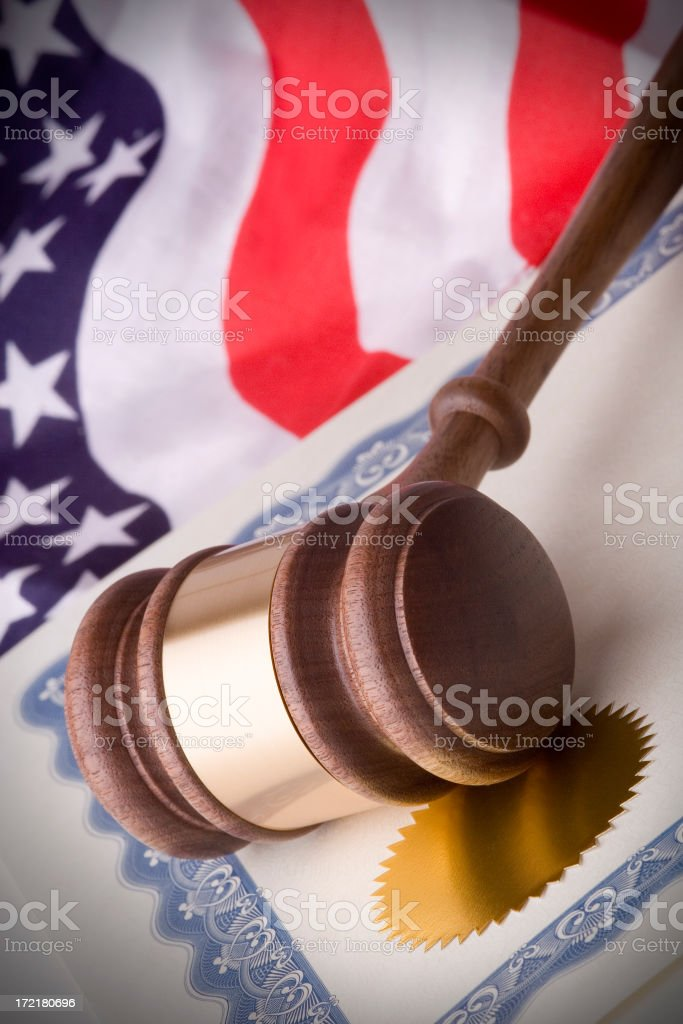 Gavel, certificate and american flag royalty-free stock photo