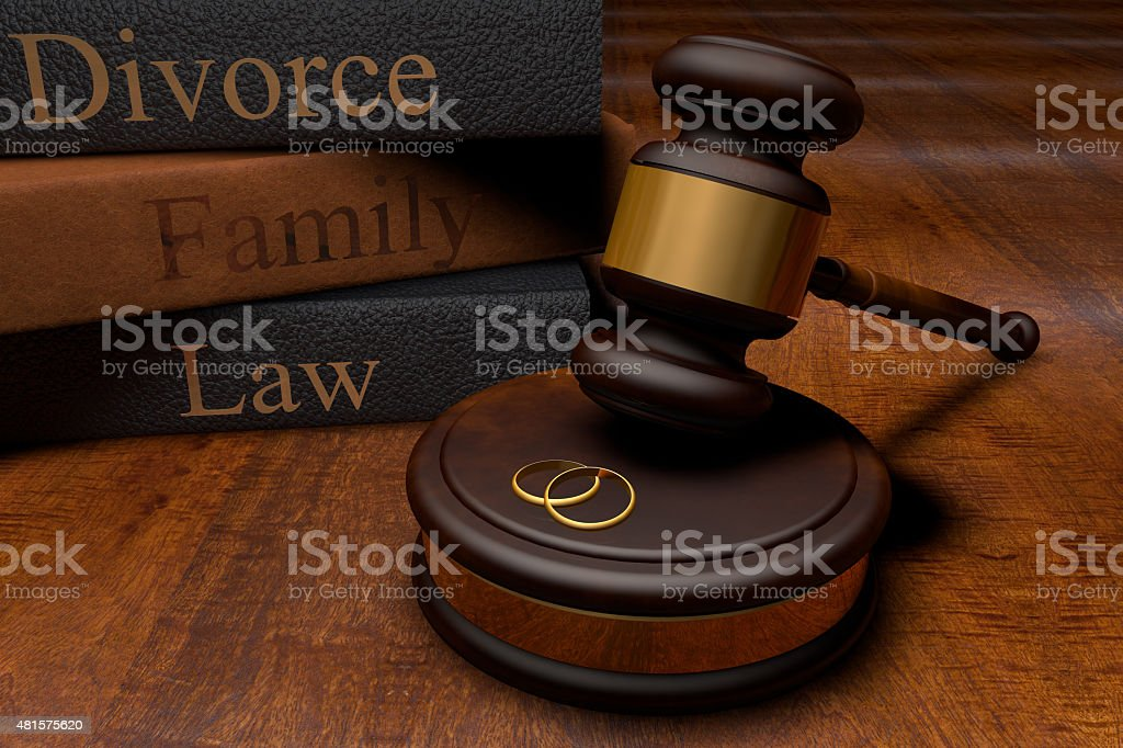 Gavel, divorce law books and wedding rings stock photo
