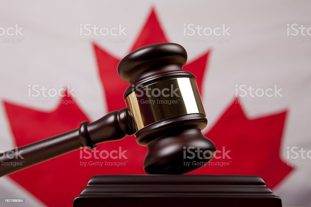 Gavel In Front Of Canadian Flag royalty-free stock photo