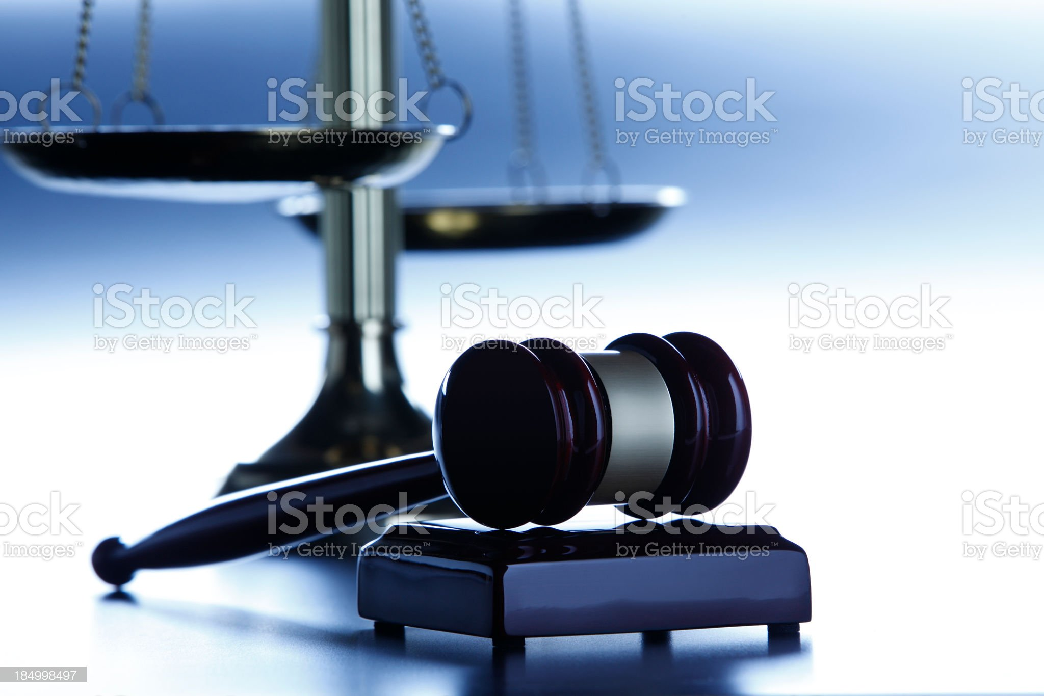Gavel in front of scales of justice royalty-free stock photo