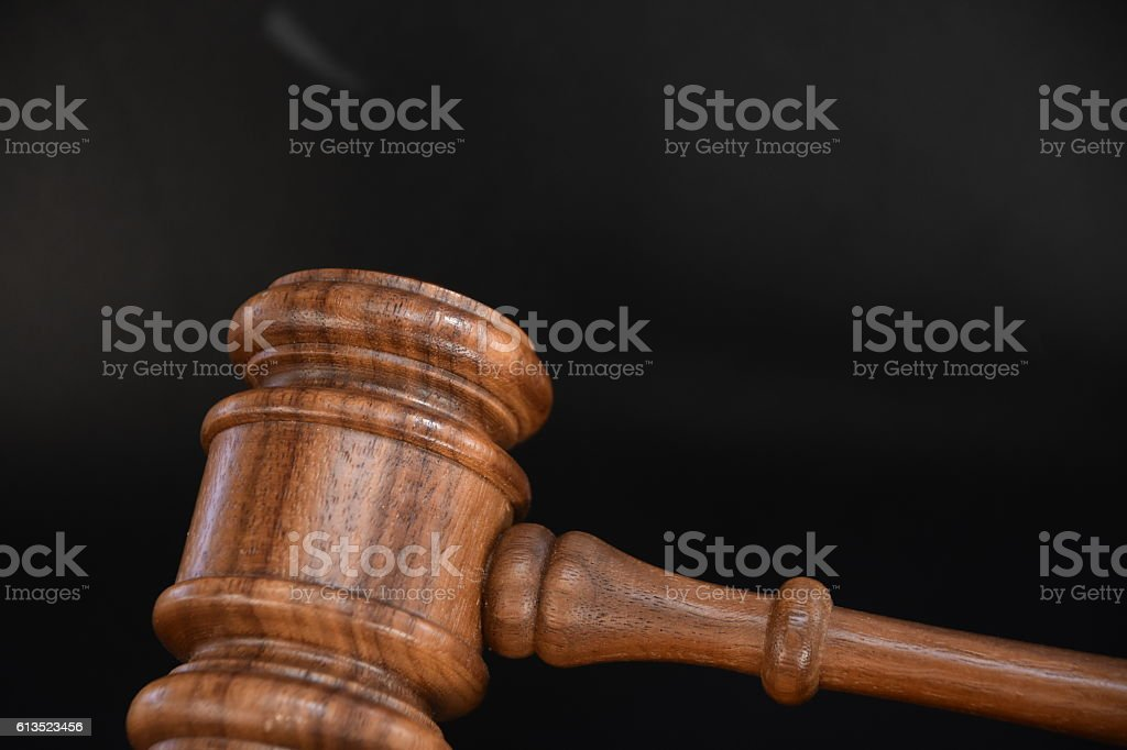 gavel isolated on black stock photo