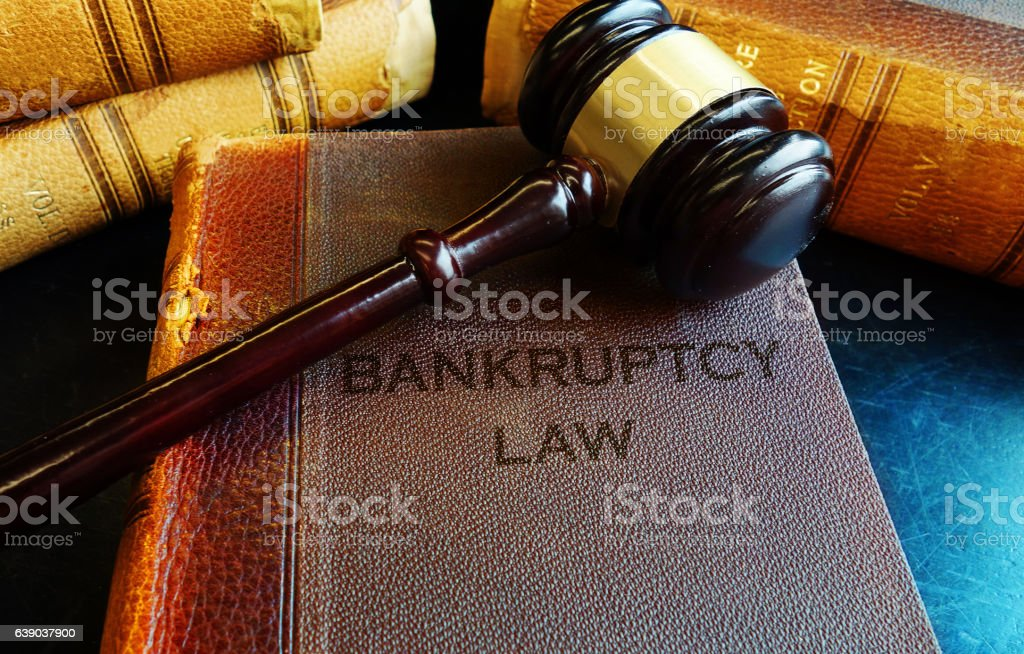 Gavel on bankruptcy Law books stock photo