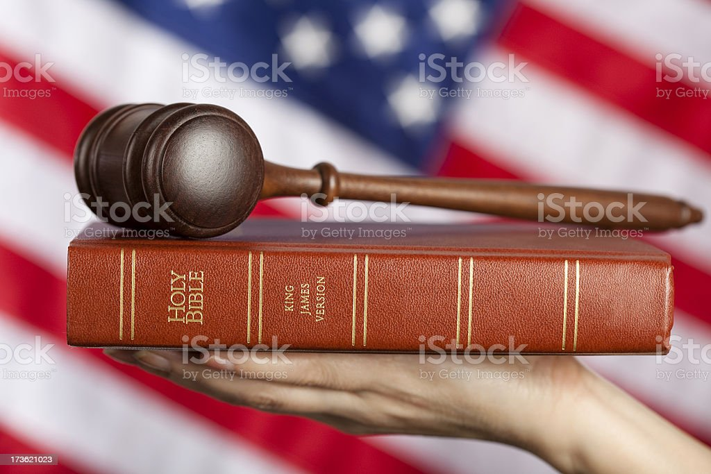Gavel on bible against US flag royalty-free stock photo