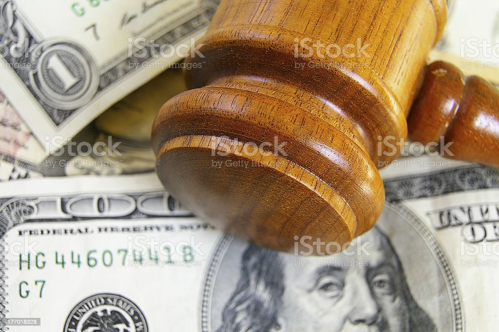 gavel on cash stock photo