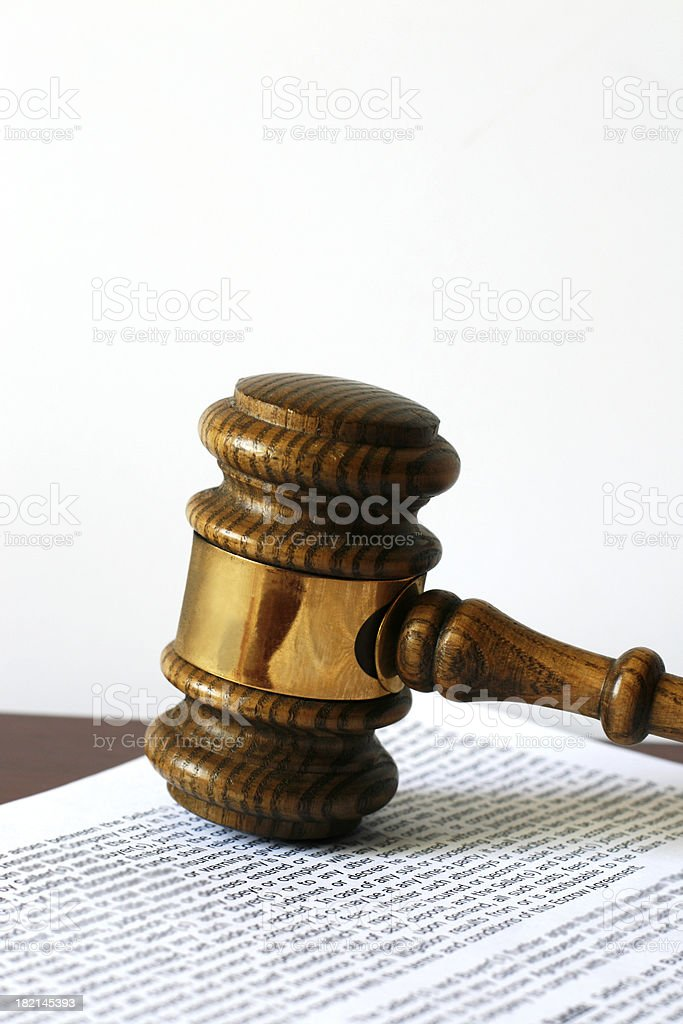 Gavel on document, vertical. royalty-free stock photo