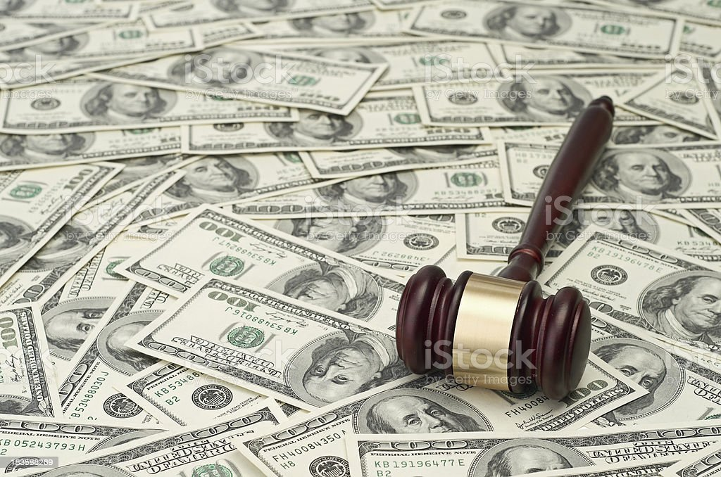 gavel on dollar background royalty-free stock photo