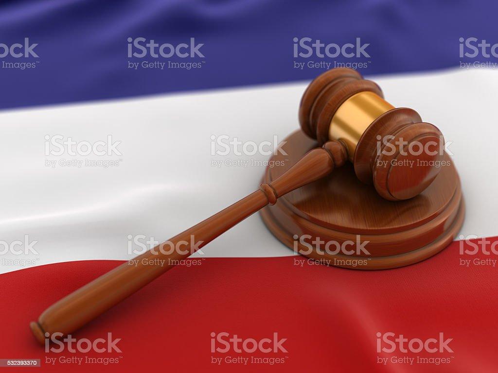 Gavel on flag of Netherlands stock photo