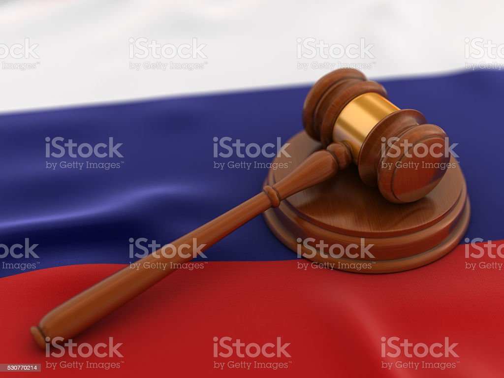 Gavel on flag of Russia stock photo