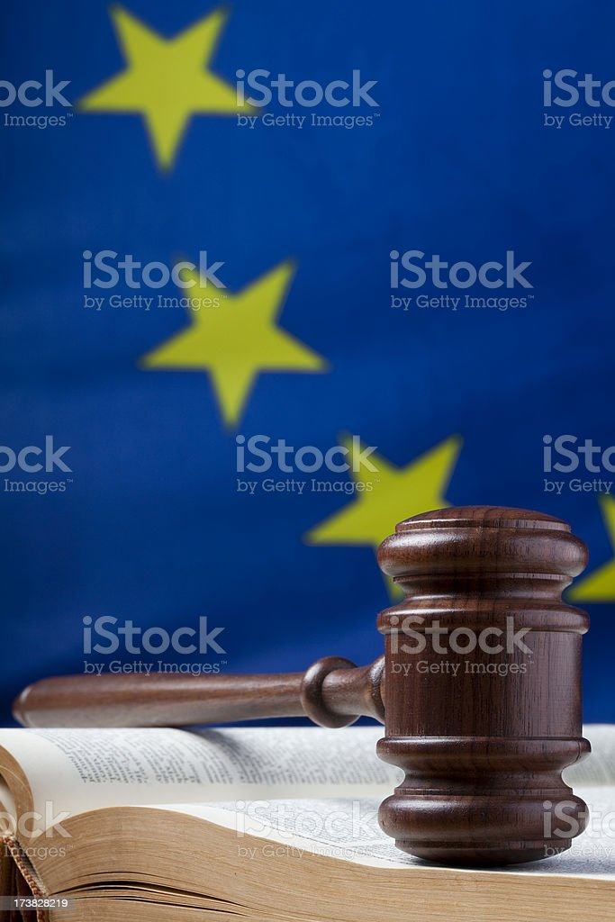 Gavel on law book and EU flag royalty-free stock photo