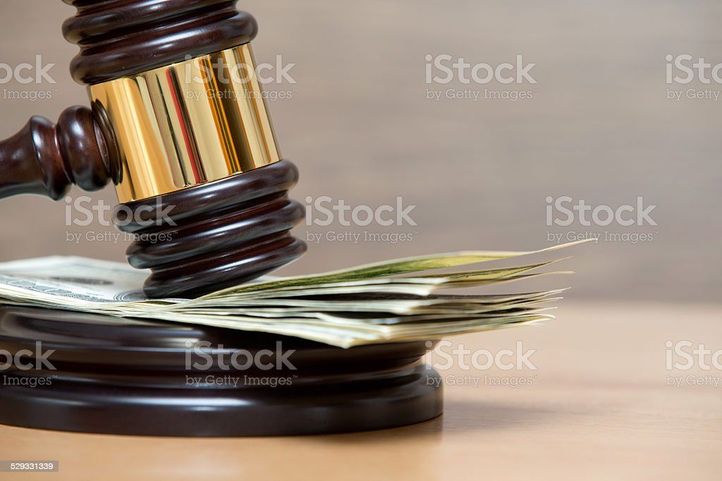 gavel on money stock photo
