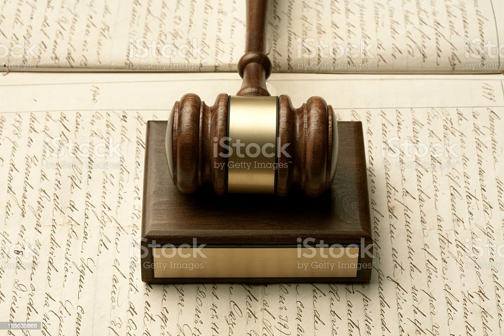 Gavel on old manuscript stock photo