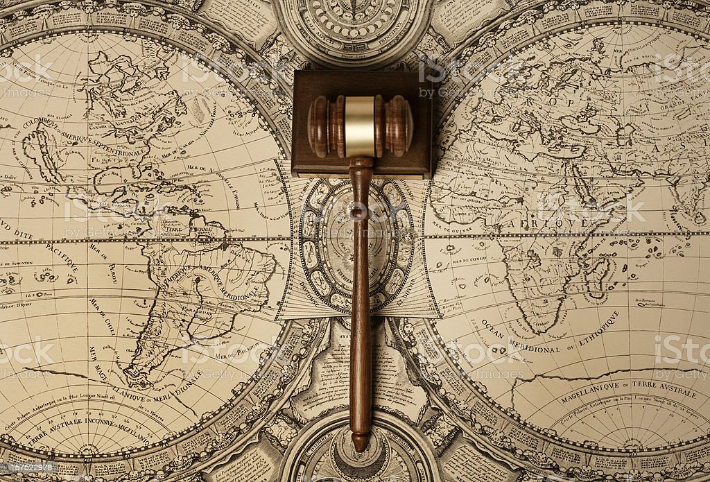 Gavel on old world map stock photo