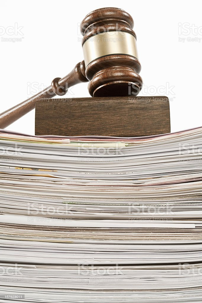 gavel on pile of documents stock photo