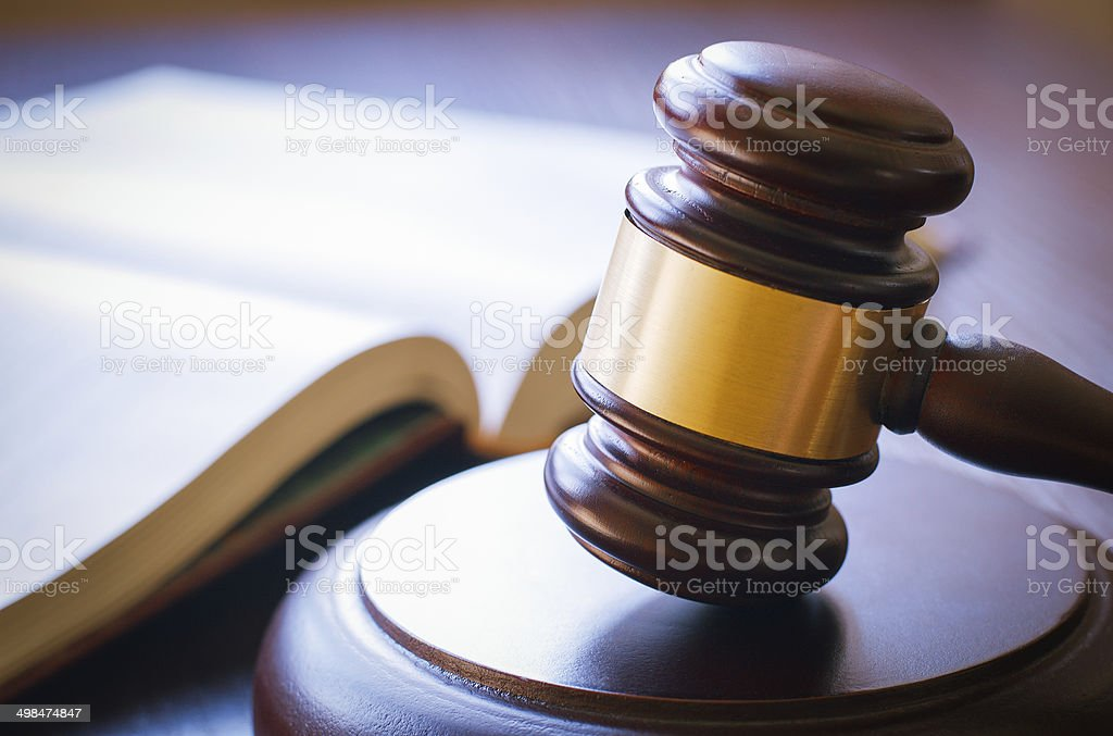 Gavel on sounding block stock photo