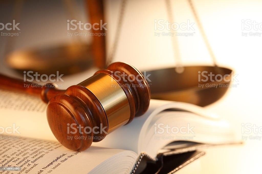 Gavel On Top Of Open Law Book stock photo
