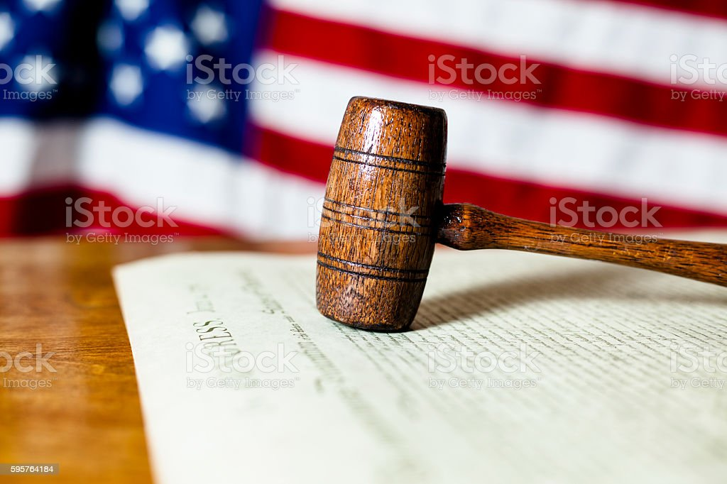 Gavel on USA Declaration of Independence with American flag. stock photo