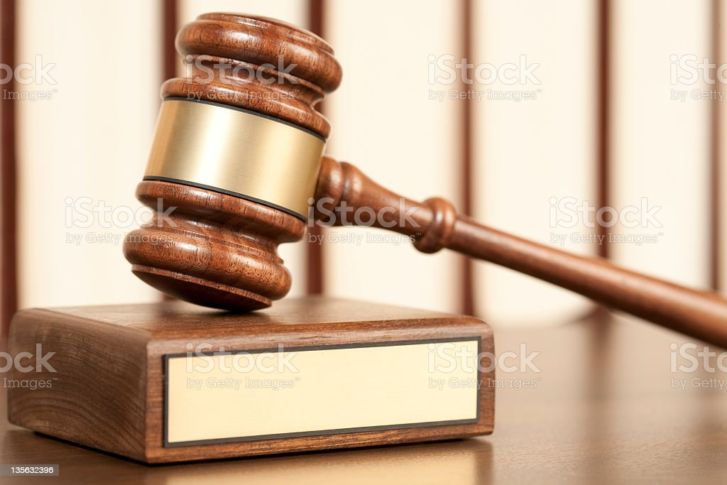 Gavel on wooden desk royalty-free stock photo