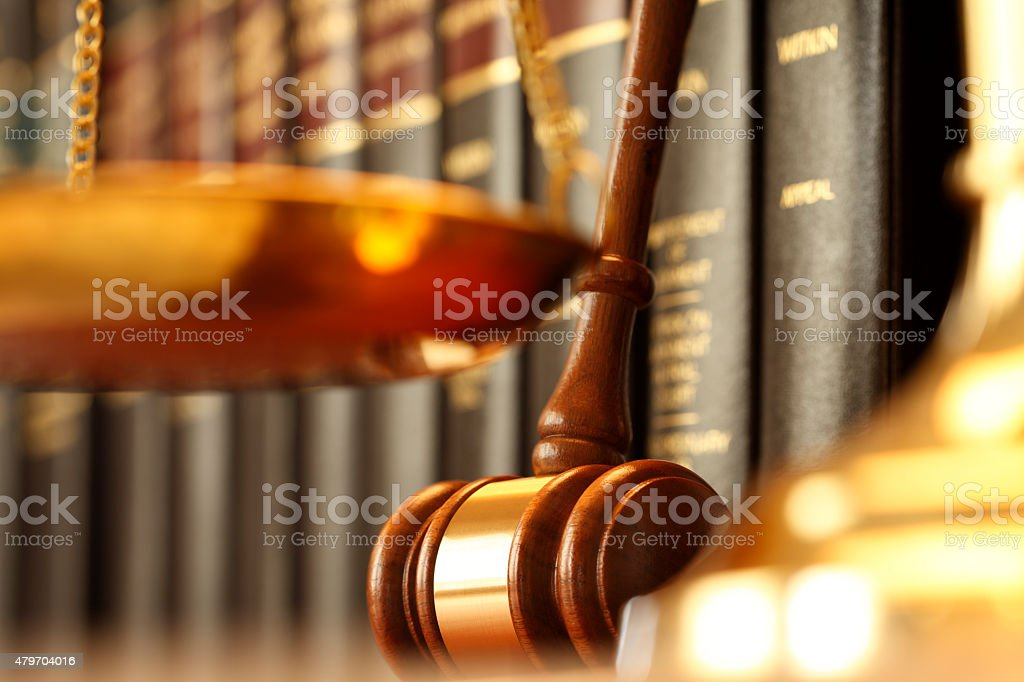 Gavel Resting Against Row Of Law Books stock photo