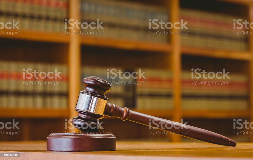 Gavel resting on sound block stock photo