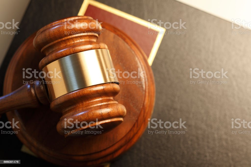 Gavel Resting On Top Of Law Book stock photo