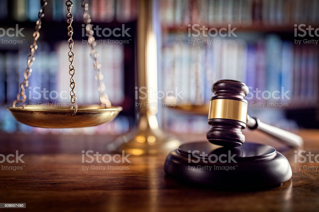 Gavel, scales of justice and law books stock photo