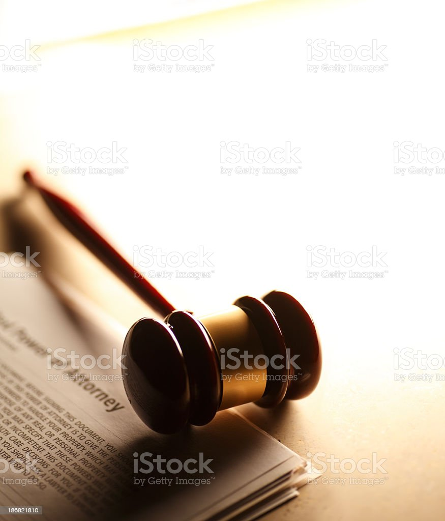 Gavel sitting on power of attorney documents stock photo