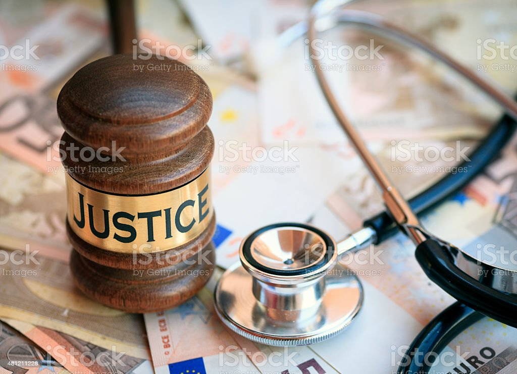 Gavel, stesthoscope and banknotes stock photo