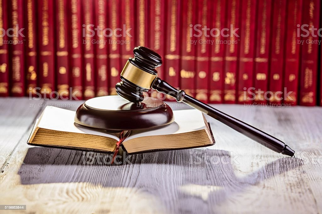 Gavel the symbol of law in court library stock photo