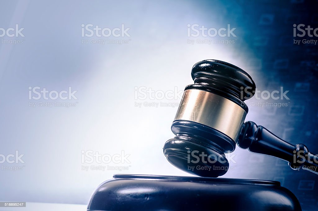 Gavel with glow go computer laptop monitor stock photo