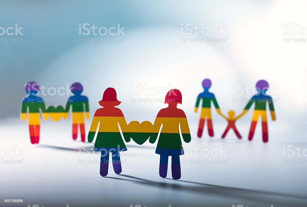 Gay couple, gay pride,  homosexual concept rainbow flag stripes stock photo