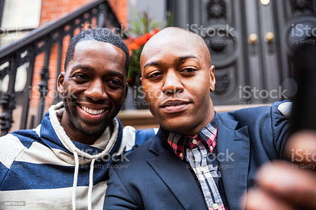 Gay couple having a selfie on steps in New York stock photo