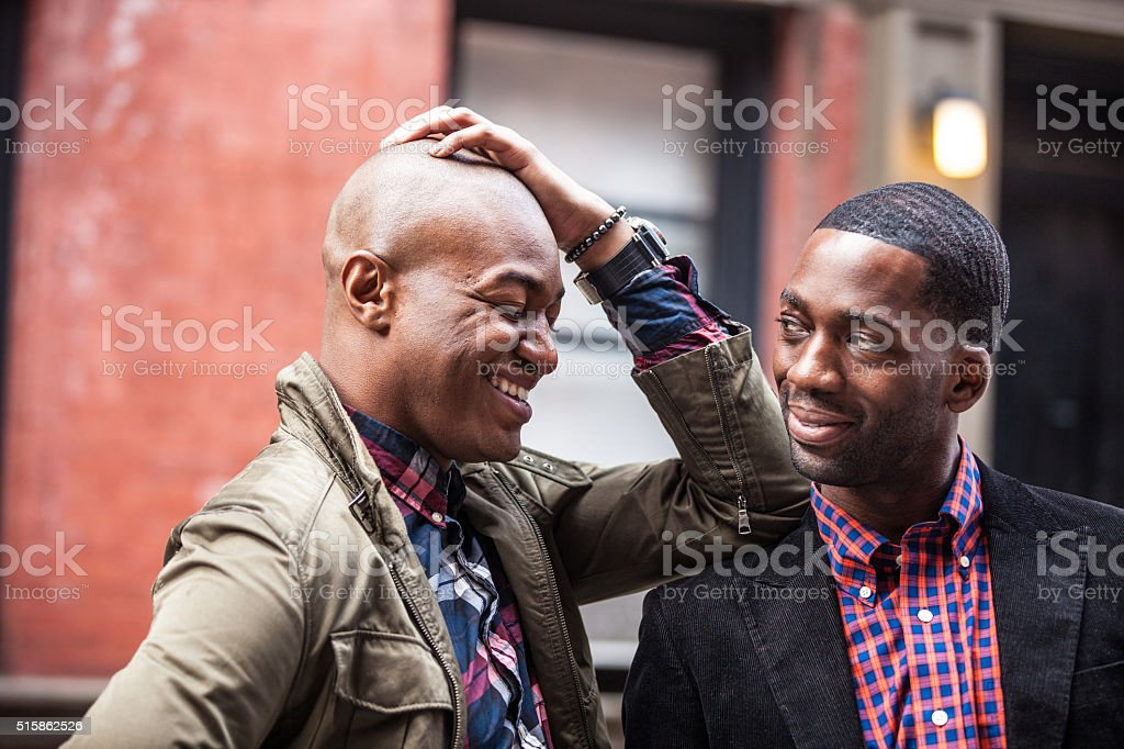Gay couple having fun together in New York City stock photo