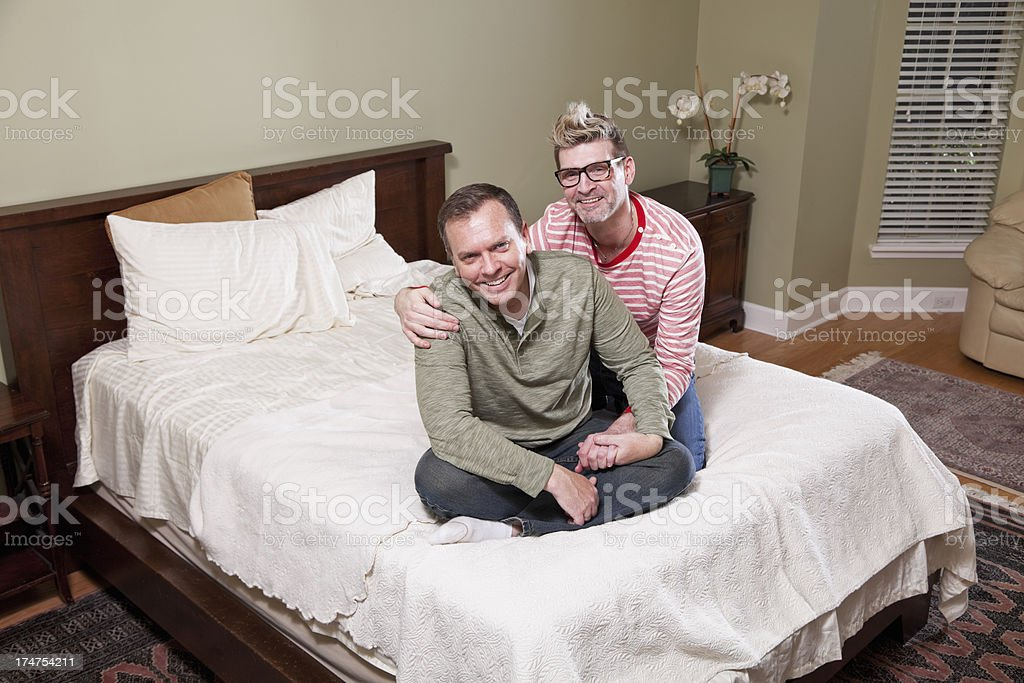 Gay couple in bedroom stock photo