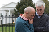 Gay Couple Looking Distraught In Front of White House