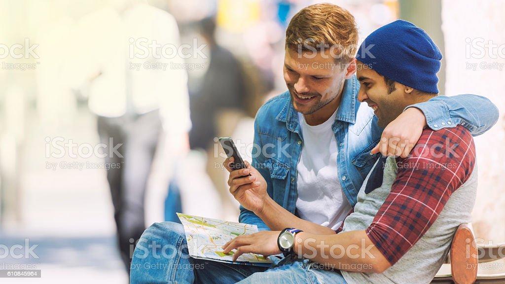 Gay couple using navigation stock photo