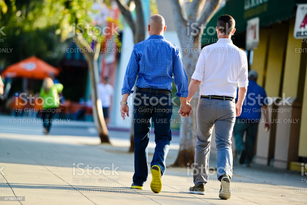 Gay Couple Walking holding hands royalty-free stock photo