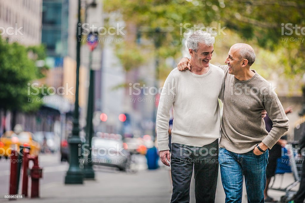Gay couple walking in New York downtown stock photo