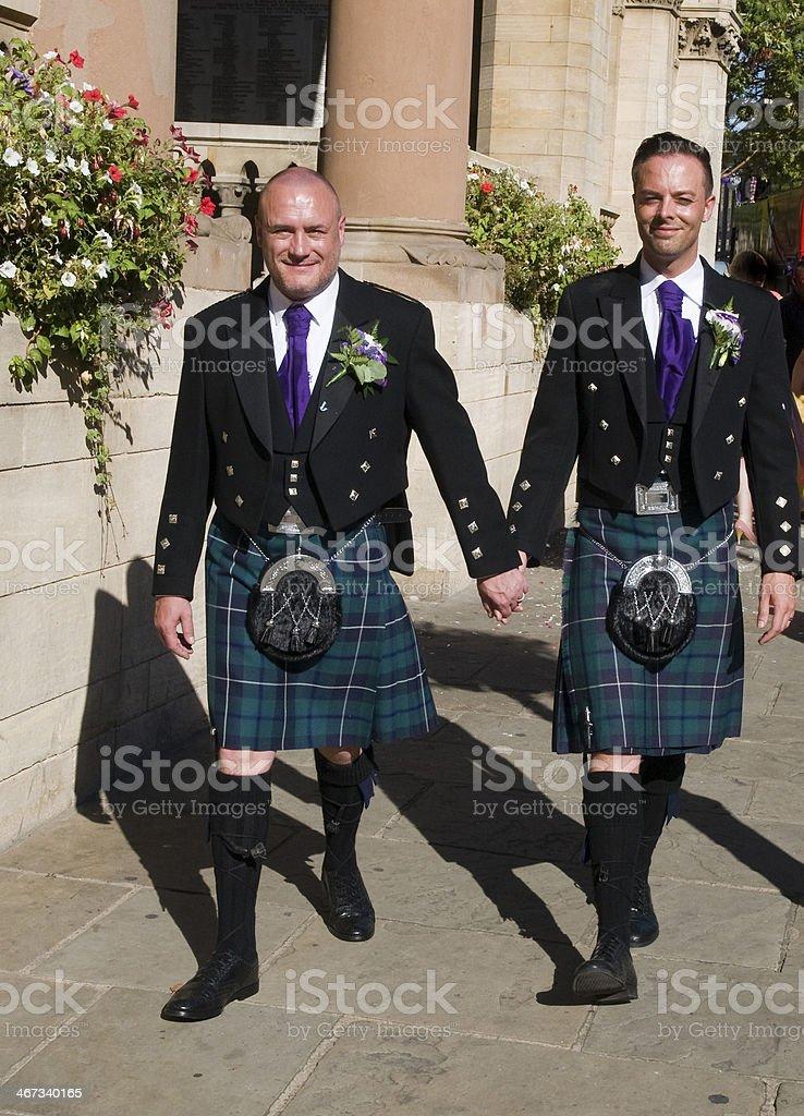 Gay couple walking stock photo