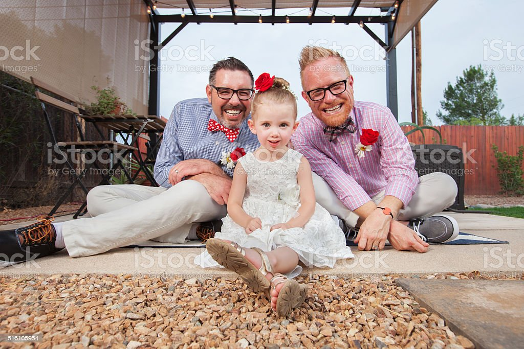 Gay Couple with Little Girl stock photo