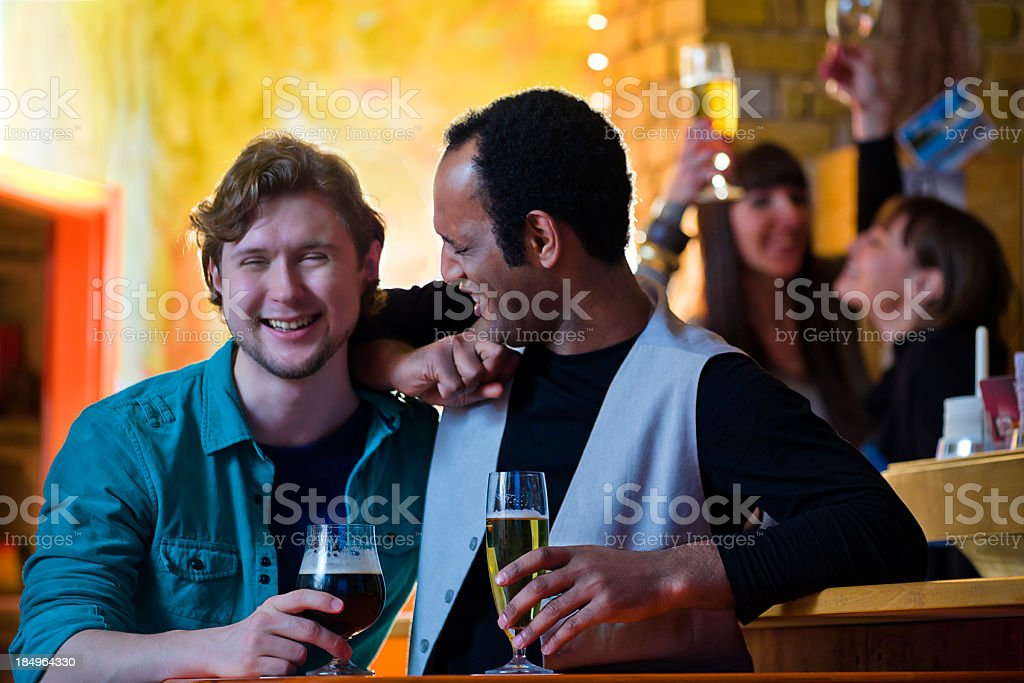 Gay Couples Enjoying Drinks in a Berlin Pub royalty-free stock photo