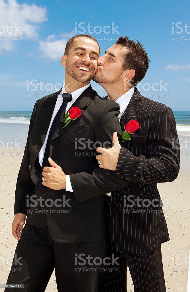 Gay grooms kissing stock photo