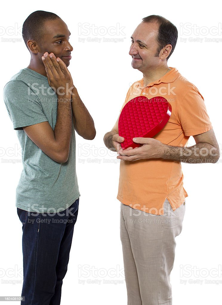 Gay Interracial Couple On Valentines Day With A Heart stock photo     Gay Interracial Couple on Valentines Day with a Heart royalty free stock photo