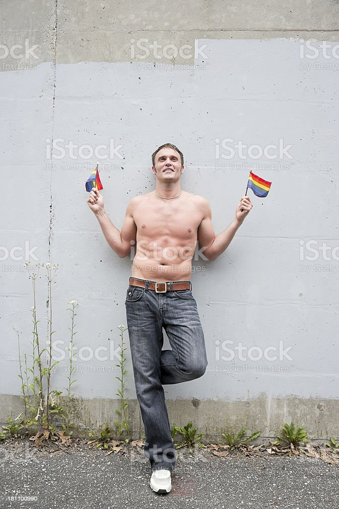 Gay Male holding GLBT Flags royalty-free stock photo