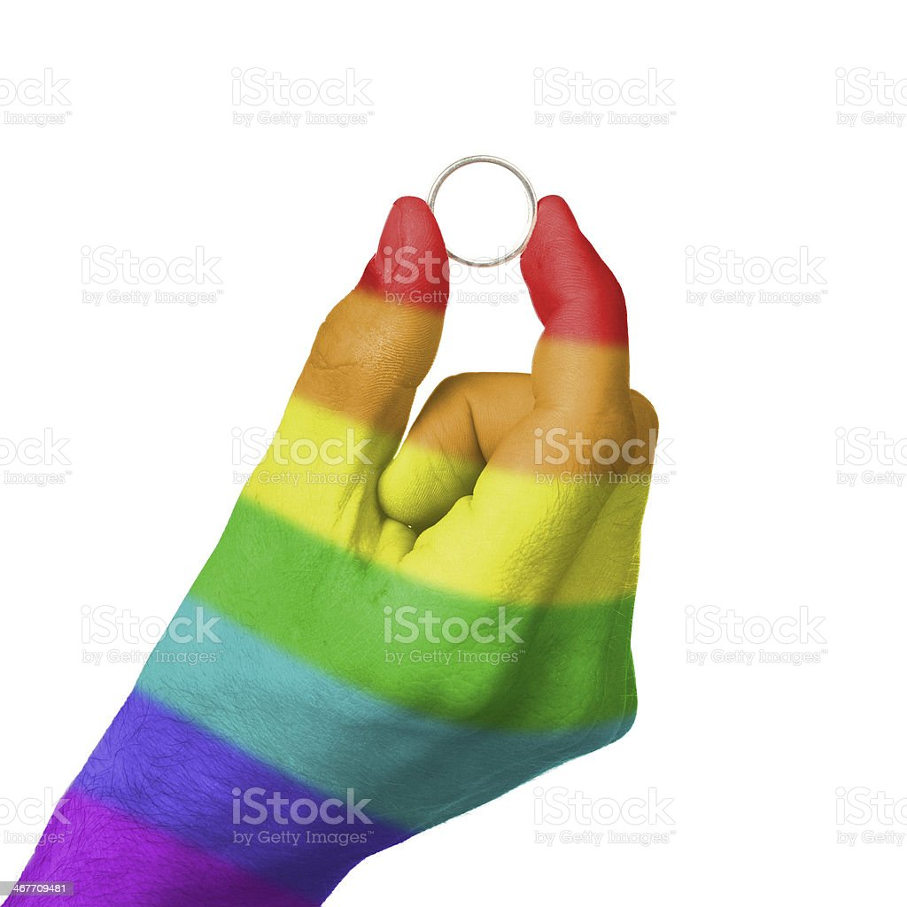 Gay man holding ring stock photo