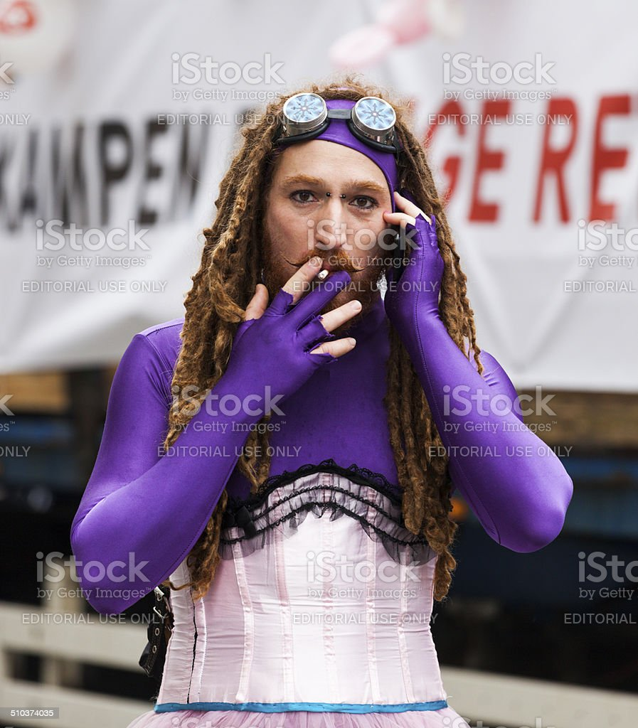 Gay man in womans dress, Pride 2014 Copenhagen. stock photo