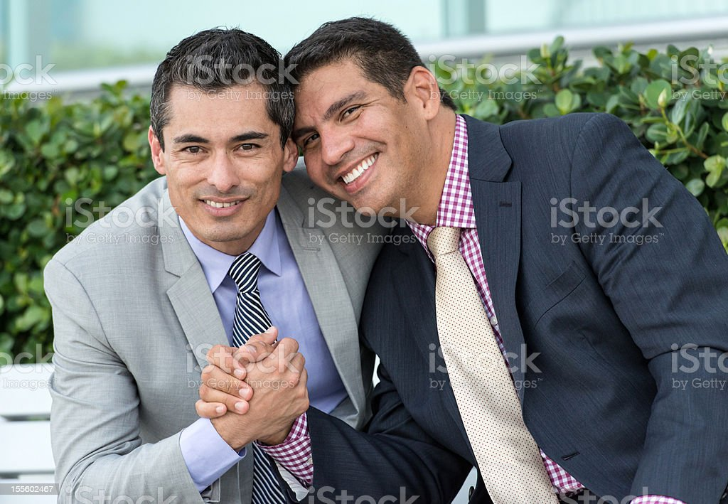 Gay mature executives holding hands royalty-free stock photo