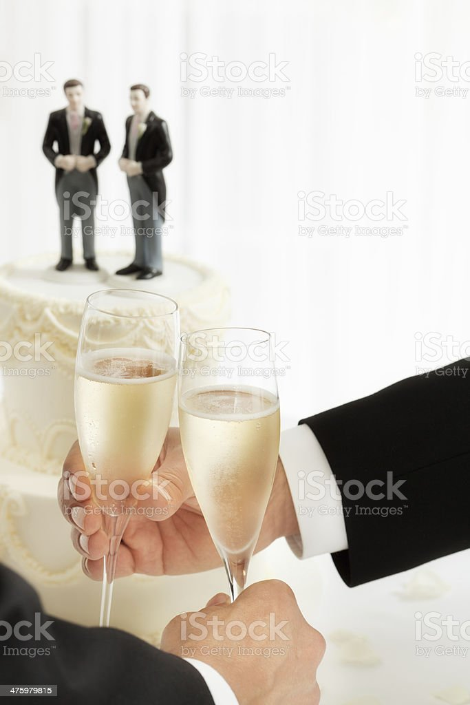 Gay Men Wedding Champagne Toast with Cake Topper royalty-free stock photo